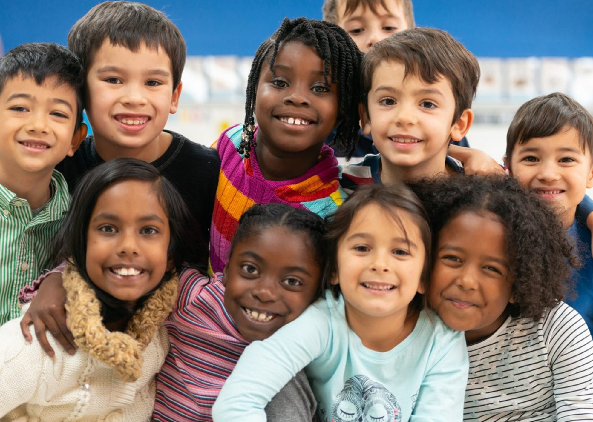 multicultural group of first graders smiling